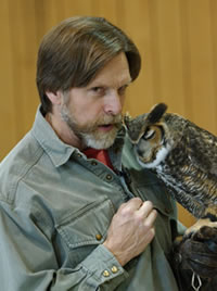 Jack Hubley whispers to his owl.